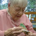 Sister Edie knits a mat for the homeless